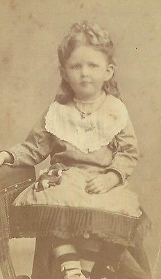 A BEAUTIFUL LITTLE VICTORIAN GIRL LONG HAIR PAST SHOULDERS NICE DRESS STRIPED SOCKS  LOCATION---UNITED STATES PHOTOGRAPHER-----UNKNOWN BLANK BACK COLOR--SEPIA ERA---1870--1880