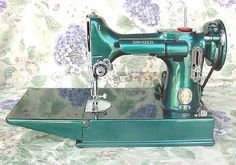 Custom Teal Paint on a Singer 221 Featherweight sewing machine. When I win the lottery, I need to buy one!