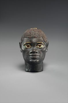 Black bronze, gold, carnelian, and obsidian head of an 'Ethiopian' depicted in Hellenistic Mode. Egyptian. Ptolemaic Period. 332-30 B.C.   The Metropolitan Museum