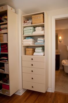 Floating #closet #cabinetry allows you to store shoes and other objects underneath.