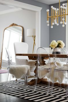 See-through furniture such as lucite (ghost) chairs and glass tables trick the eye into thinking there is more open space than there actually is | how to make a small room look bigger—25 interior design tricks that really work!
