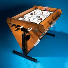 The Four in One Rotating Game Table - Hammacher Schlemmer