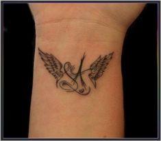 Angel wings tattoo tattoo ideas for moms Dad Tattoos, Mini Tattoos, Couple Tattoos, Body Art Tattoos, Small Tattoos, Celtic Tattoos, Sleeve Tattoos, Wing Tattoos On Wrist, Neck Tatto