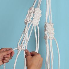 Make a modern macrame hanging planter. We used a simple clothesline - check out our tutorial!