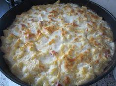 Sedani al forno con ricotta, patate e prosciutto.