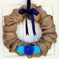 20 inch Custom Burlap Wreath with Bow and Your Choice Colored Fabric Flowers. $45.00, via Etsy.