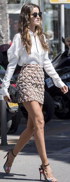 Who made Izabel Goulart's cat sunglasses, floral skirt, black handbag, and print sandals?