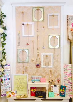 Jewellery display wall in Breda's Gift Shop using wooden dowels, picture frames and wallpaper.