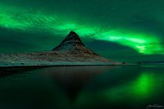 https://flic.kr/p/Uo79Sm   The Light Show   Watching the aurora dance across the sky is one of the most amazing things. I just wanted to stop time as the sky lit up behind Kirkjufell, so I'd never lose that feeling of awe and amazement that nature can bring.  www.openlightlightphoto.com