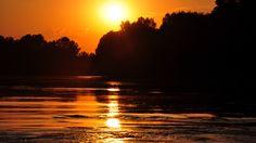 Solnedgång med spegling