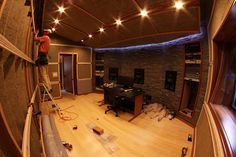 Installing Wallmate acoustical fabric system tracks. With audience.