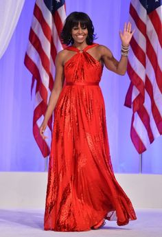 First lady Michelle Obama waves at the Commander-in-Chief's Ball, honoring U.S. service members and their families, at the Walter E. Washington Convention Center, Jan. 21, 2013.