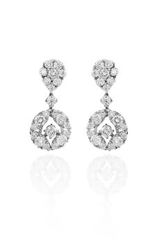 "You will exude delicate elegance in Haute Vault's 18K white gold and diamond cluster tear drop earrings. These beautiful earrings pair well with a simple or embellished gown. Measures 1"" long"