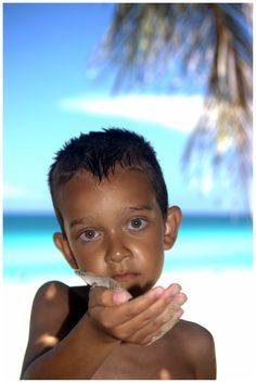 Varadero, Cuba. This little boy reminds me a little of my husband when he was little, same skin tone and eyes...