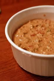 Crock Pot Taco Dip..  1 lb. ground chuck  1 lb. sausage (ground)  1 c. picante sauce  10 34 oz. cream of mushroom soup  6 ozs. cream cheese  1 tsp. garlic powder  1 can rotel tomatoes  3/4 tsp dried oregano  6 green onions  1 can olive (sliced black or green)  1/2-1 c. nuts (choice)  1 can refried beans