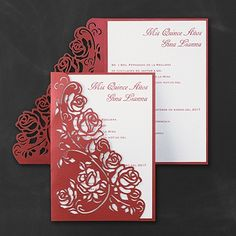 A red shimmer wrap with a laser-cut rose pattern encloses your invitation.