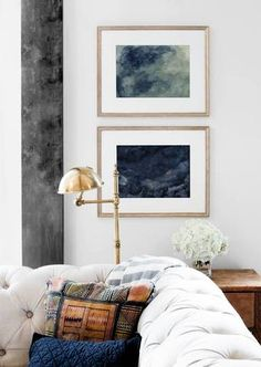 art collecting stacked framed photos in living room