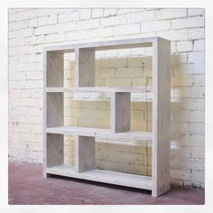 Bespoke bookcase in a white wax-oil ↟