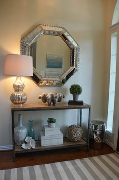 transformed a clients dated entry with a coastal chic vibe.  We found coral, vases and fun storage boxes all from HomeGoods