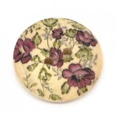 http://www.plushaddict.co.uk/haberdashery/buttons/round-wooden-plum-green-floral-buttons-23mm-pack-of-3.html Round Wooden Plum & Green Floral Buttons 23mm 3 pack