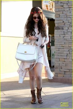Try combat boots with a high-low dress like Selena Gomez in her Steve Madden Troopa Boots here.