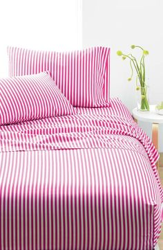 Pink stripes create a fun bedroom!
