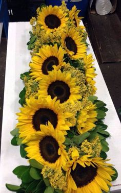 Sunflower Top Table Garland Idea, however we would add some white flowers and other textures to add interest and break up the yellow .Price will depend on choice of flowers and size required. per foot. Sunflower Centerpieces, Sunflower Arrangements, Sunflower Bouquets, Wedding Arrangements, Floral Centerpieces, Wedding Centerpieces, Wedding Decorations, Centerpiece Ideas, Sunflower Party