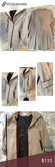 """Calvin Klein Twill Wool Coat with PU Trim NWT A sleek dress coat for work and weekend.  Wool-blend twill coat with faux leather polyurethane trim contrast.  Belted double snap-button strap accents the cuff. Asymmetrical front zip.  Coat is Lined Shell: 60% wool, 35% polyester, 5% other fibers Measurements: Length: 36"""" Coat color is Oatmeal Calvin Klein Jackets & Coats"""