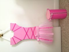 A ballerina bow holder on the skirt and a headband holder.. I made myself :) want one ask me!