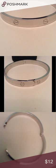 Love bracelet stainless steel NWOT Brand new never worn stainless steel love bracelet with screw design all around. Clasp snap closes securely. Will not turn color. Fits smaller wrist. stainless steel Jewelry Bracelets