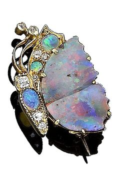 An opal and diamond-set butterfly brooch, circa 1900 Designed as a butterfly in profile, the wing set with an opal plaque in closed-back setting, the body with circular and oval cabochon opals, accented by cushion-shaped diamonds, length 3.2cm