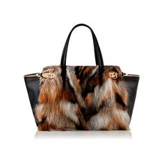 """Ferragamo Pre-Fall 2013 Zip Tote. Medium tote featuring two side pockets with zipper detailing and gold zip Gancio ornaments, snap closure, removable interior zip pocket and cell phone holders. Double leather handles with 7.5"""" drop. Lined in suede. Collection FW 2013"""