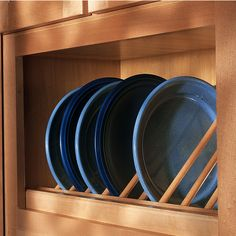 Display your treasured china and plates with this Angled Plate Display Rack from Omega National. The angled plate display kit is available in Red Oak, Cherry, Hickory and Maple to match any kitchen. The dowels measure 3/8'' in diameter. The angled display rack offers easier access to your dinnerware with different sizes available. Both plate display units come pre-assembled and can be trimmed to fit most cabinets.