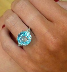 This stunning ring combines classic design with a unique gemstone to create a truly spectacular ring which is sure to be loved for many years to come. The ring features an incredible 2.60CT oval cut blue topaz which emanates beautiful rays of sky blue light. The blue topaz is further enhanced by the crisp white sparkle of the 0.01CT Premium Quality Diamonds and 9K white gold band. #thediamondstoreuk #bluetopaz #ring #jewellery