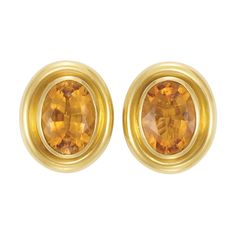 Gold and Citrine Earclips, Tiffany & Co., Paloma Picasso  18 kt., centering 2 collet-set oval citrines approximately 22.00 cts., within polished bombe gold, signed Tiffany & Co., Paloma Picasso, approximately 24 dwts.