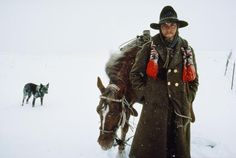Picture of a horse wrangler in the snow
