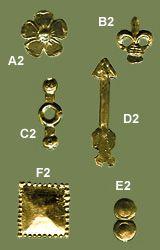 Studs (Set 2)    Century - Sources:  13th-15th  Material:  brass  Notes:  A2 - B2 - C2 - E3 - F2 - length/diameter cm. 2 (approx)  D2 - lenght. 3,5 cm  basic set 7 studs  € 15.00  standard set 12 studs  € 23.00  deluxe set 18 studs  € 34.00