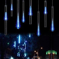 From Led Meteor Shower Rain Lights - Surlight Falling Rain Drop Christmas Lights Icicle Snow Fall Waterproof String Lights With 8 Tube 144 Leds For Holiday Xmas Tree New Year Halloween Wedding Party Decoration (blue)