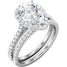 pear shape halo engagment ring  #www.nzjewellers.co.nz #wwww.nzdiamonds.co.nz #hand made engagment rings #g.i.a #pear shape #halo engagment rings
