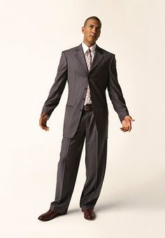 Tall Man Don'ts:  • Don't buy suits with oversize, padded shoulders. They swallow you up, making you look frailer, not bigger.  • Don't wear extra-slim ties. You need ties with a bit of width so they won't appear to elongate your torso.