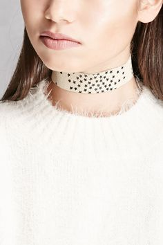 A textured leather choker by JJ Winters™ featuring a star print and a dual snap button closure for an adjustable length.
