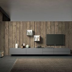 TV Unit composition Radical by Morassutti, features 3 wooden wall mounted units and a wooden base unit