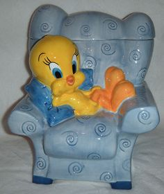 Tweety Bird in a Chair. The Warner Bros Studio logo is under the glaze on bottom and it is dated 1999.