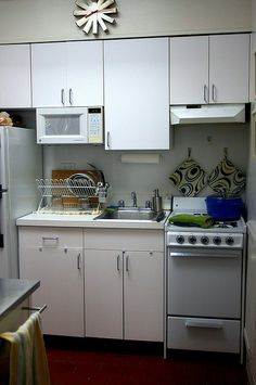 mostly white by smitten, via Flickr organize small kitchen. a lot of good  ideas here, eg: magnetic knife rack, a pots & pans rack, and a kitchen-aid mixer, (yes, really.)
