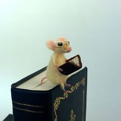 These bookish mice will guard your page for you. | 24 Brilliant Bookmarks You Need In Your Life