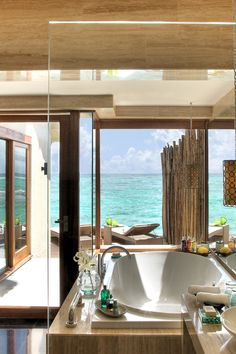The hotel comprises 62 thatch-roofed villas, like this Premium Indulgence Beach Villa. #Jetsetter