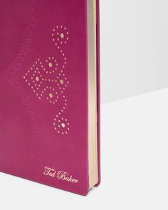 SHOP FOR HER: For the lady who likes to scribe, put pen to paper with Ted's delicate pink notebook. Scribe your most important memos in this beautifully designed journal, crafted with a ribbon bookmark and ruled paper for ultimate practicality.