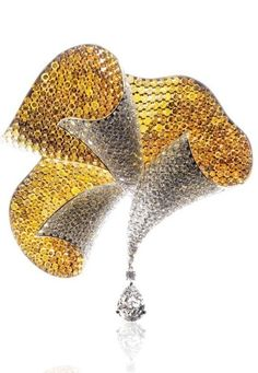 Ventaglio (Fan) broach, set with white and cognac diamonds, and a 5ct pear-shaped white diamond drop. The Titanium's strength permitted less structural metal than would have been needed with Gold or Platinum, allowing the diamonds to entirely obscure the structure.