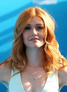 Katherine McNamara looked chic and classy as she went for minimalistic look with a white flared leg jumpsuit that had a very plunging neckline which gave an eyeful of her ample cleavage and had a belted detail in the middle to draw attention to her slender waist as she joined other famous names such as Sarah Hyland on the blue carpet at the premiere of Finding Dory on June 8, 2016 in Hollywood.