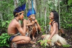 Music in the Amazon - Two Amazon kids play panpipes for their friend. Photo by David Lazar.
